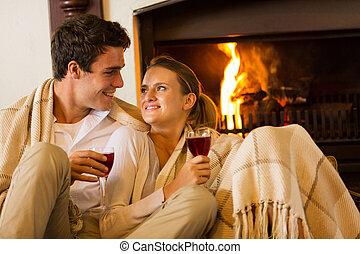 couple spend romantic evening drinking wine