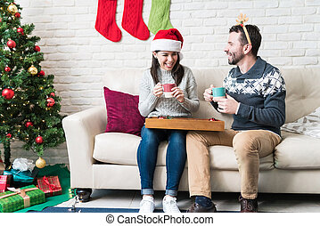 Couple Spending Leisure Time At Home During Christmas