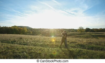 Couple Standing in a Meadow