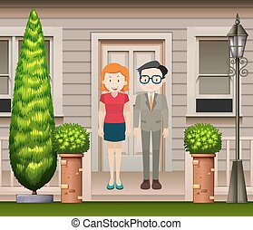 Couple standing in front of the house