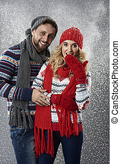 Couple standing in the snowy blizzard