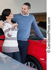Couple standing next to a car