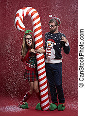 Couple standing next to the candy cane