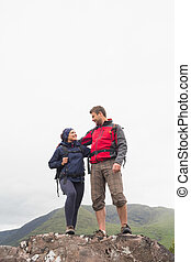 Couple standing on a rock embracing