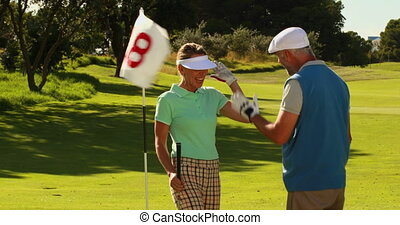 Couple standing on the putting green