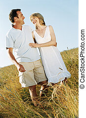 Couple standing outdoors smiling