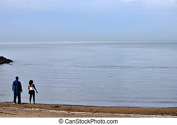 Couple stares out at Lake Erie