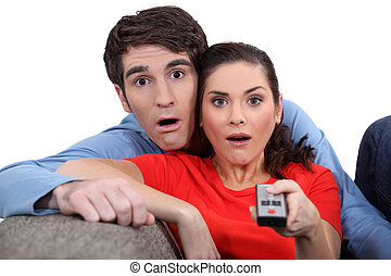 Couple staring at the screen in disbelief
