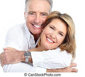 Couple - Senior smiling couple in love. Over white...