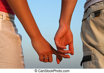 couple - a couple holding each other's hand