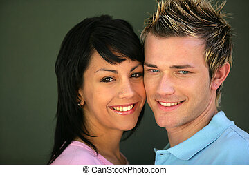 Couple stood cheek to cheek