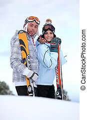 Couple stood with their skis