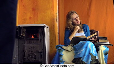 couple stove wine book - man bring glass of red wine his...