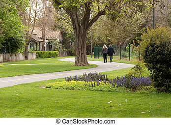 couple strolling along curvaceous path