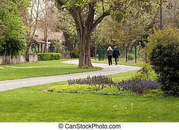 couple strolling along curvaceous path