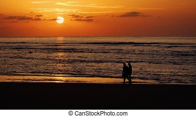Couple Strolling along Phuket Tropical Beach at Sunset....