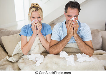 Couple suffering from cold in bed - Couple suffering from ...