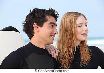 couple, surfers