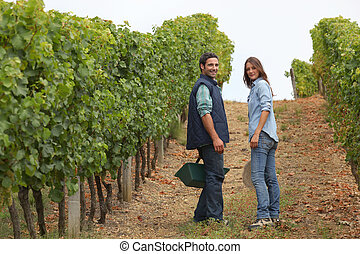 Couple surrounded by vines