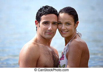Couple swimming on holiday