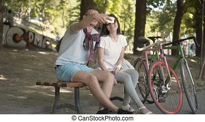 Couple Take Selfie near Bikes