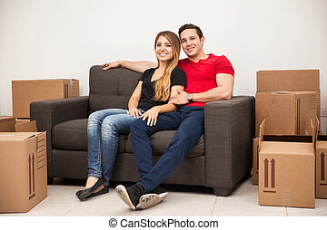 Couple taking a break from moving