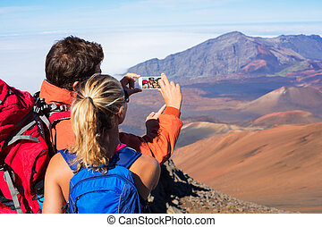 Couple Taking a Photo of Themselves with Phone - Happy...
