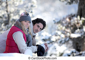 Couple taking a romantic walk in the snow