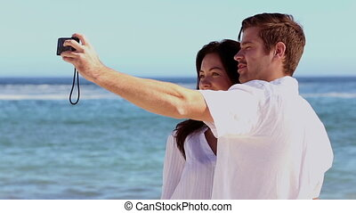 Couple taking a self portrait - Couple taking a self...