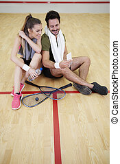 Couple taking a selfie after finished squash game
