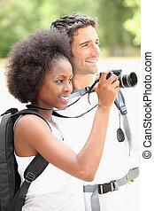 Couple taking photographs of wild life