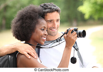 Couple taking photos outdoors