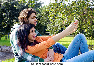 Couple taking picture with iphone - Happy couple making...