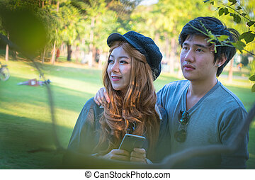 Couple taking pictures from mobile phones