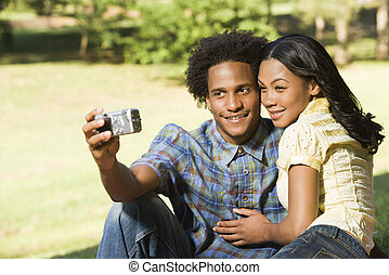 Couple taking pictures.