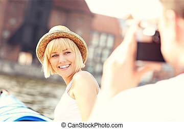 Couple taking pictures on kayaks