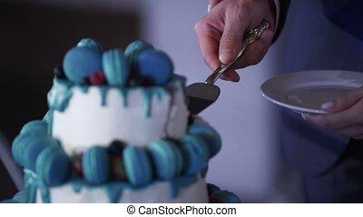 Couple taking piece of wedding cake