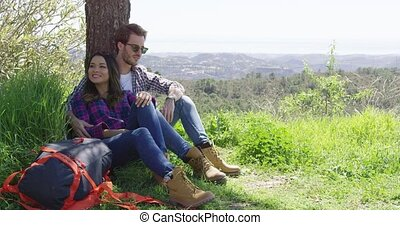 Couple taking rest together - Young smiling couple taking...