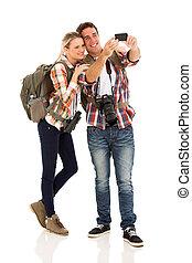 couple taking self portrait - beautiful couple taking self...
