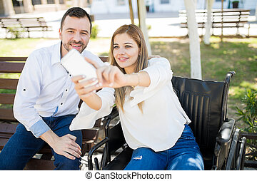 Couple taking selfie at a park