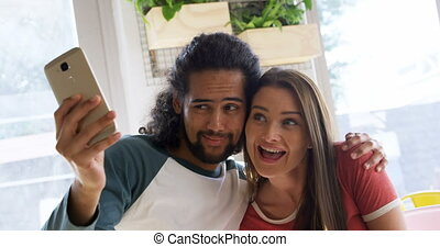Couple taking selfie in cafe 4k - Young couple taking selfie...