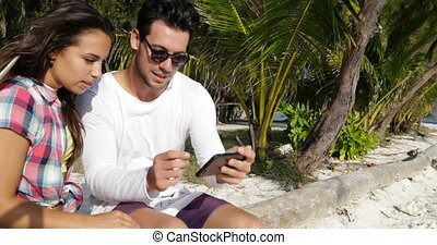 Couple Taking Selfie On Cell Smart Phone Outdoors Under Palm...