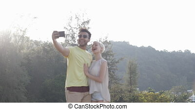 Couple Taking Selfie Photo In Mountain Park, Hispanic Man...