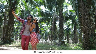Couple Taking Selfie Photo On Cell Smart Phone Trekking In...