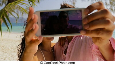 Couple Taking Selfie Photo On Cell Smart Phone On Beach...