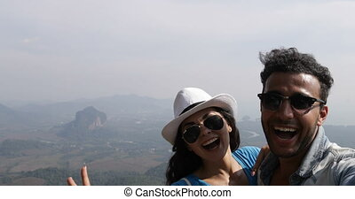 Couple Taking Selfie Photo On Mountain Top Happy Smiling...