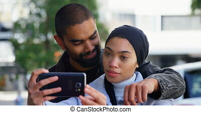 Couple taking selfie with mobile phone 4k