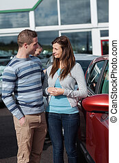 Couple talking about a new car