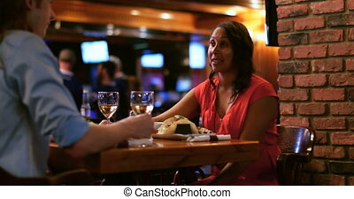 Couple talking at table 4k - Romantic couple talking at...