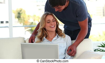 Couple talking in front of a laptop